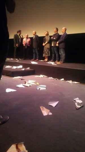 The creative team behind Despicable Me 2 amidst a flurry of paper airplanes.