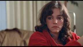Elizabeth (Brooke Adams) begins to suspect something is off with her husband