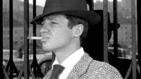 Michel Poiccard depicting a typical gangster