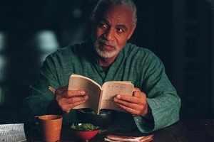 Shepherd Book reading his Bible