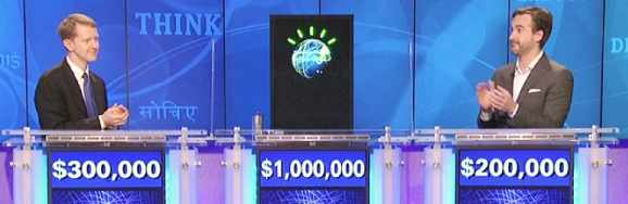 Watson (center - obviously) playing, and winning, Jeopardy! in 2011.