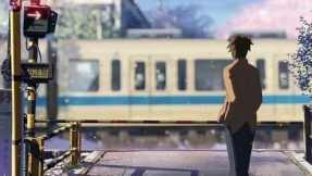 Takaki looking back to see if Akari is standing on the other side of the train crossing.