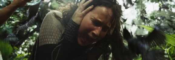 Jennifer Lawrence as Katniss Everdeen attempting to block out the screams of her loved ones.