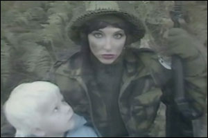 Kate Bush representing Motherhood of a deceased solider, represented as a vulnerable boy.