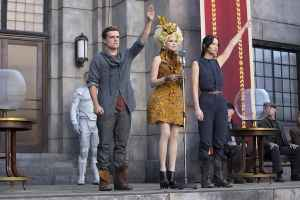 Peeta and Katniss saluting District 12 after they have been chosen to participate in the 2nd Hunger Games.