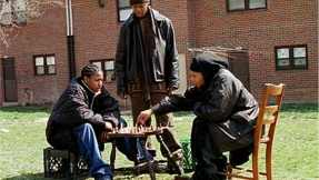 D'Angelo (center), explaining chess to Wallace (left) and Bodie (right), triangulated in a way as to distinguish a hierarchy within the Barksdale crew