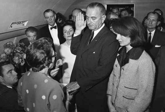 LBJ sworn in as President following JFK's assassination (1963). Cecil Stoughton