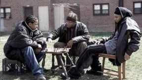 D'Angelo (center) instructing Bodie (right) and Wallace (left) on how to play chess