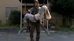 "Daryl carries Beth's body in ""Coda."""