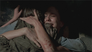 Lori hugs Carl before she dies.