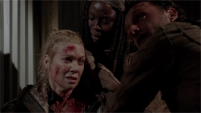 "Michonne holds Andrea in ""Welcome to the Tombs."""