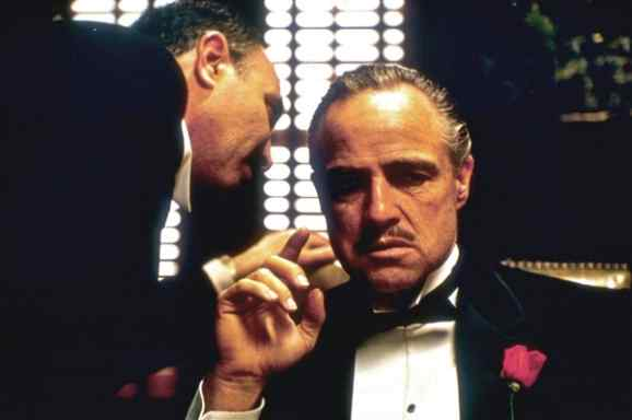 """During the opening scenes of Godfather, when Don Vito Corleone (Marlon Brando) is told of the plea by an Italian client at his office who seeks """"justice""""."""