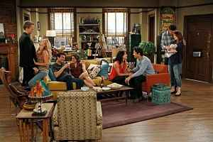 HIMYM characters sitting around with significant others.