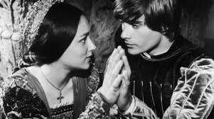 """Romeo: """"If I profane with my unworthiest hand This holy shrine, the gentle fine is this: My lips, two blushing pilgrims, ready stand To smooth that rough touch with a tender kiss."""""""