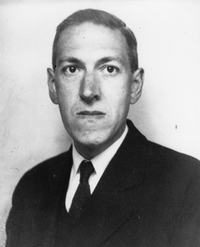 A portrait photograph of H. P. Lovecraft, taken June 1934.