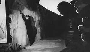 Cesare's movements are telegraphed by the Expressionist set.