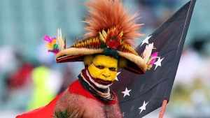 Papua New Guinean man with headdress, assertion of identity in relation to a community.