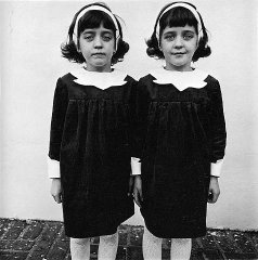 "Diane Arbus was especially famous for her portraits of twins. This one, ""Identical Twins, Roselle, New Jersey"" (1967), is perhaps her most notable. Featuring two identical young girls, each wearing a strikingly different facial expression, the image is unsettling."