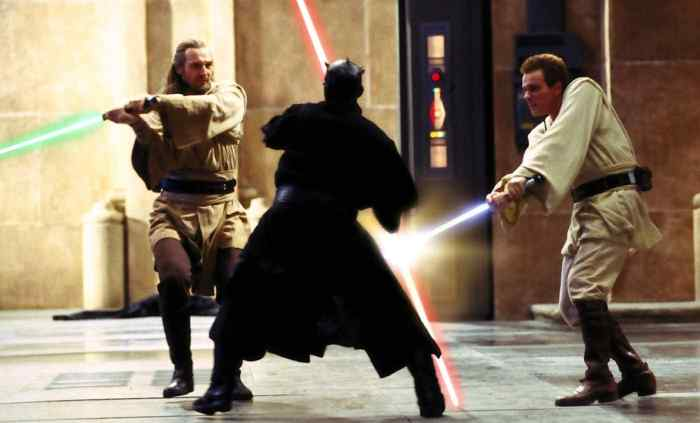 "Qui-Gon Jinn and Obi-Wan Kenobi engage in the famous lightsaber duel with Darth Maul from ""The Phantom Menace"""