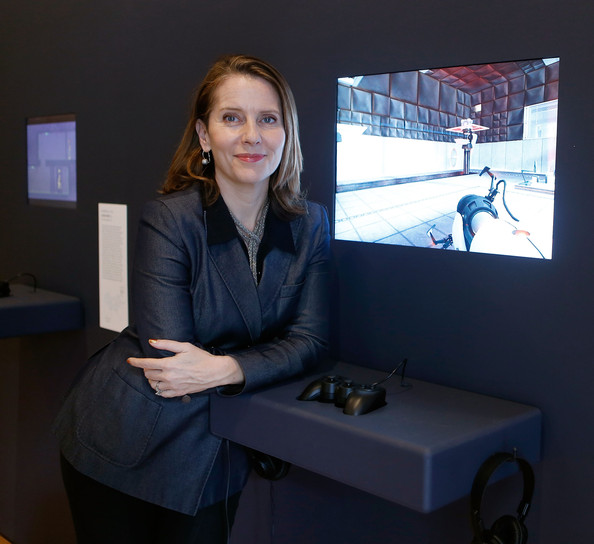 Applied Design organizer Paola Antonelli posing next to exhibit installation