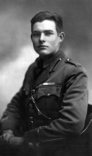 """Ernest Hemingway, 1918, American Red Cross volunteer. Portrait by Ermeni Studios, Milan, Italy. """"Ernest Hemingway Photograph Collection, John F. Kennedy Presidential Library and Museum, Boston""""."""