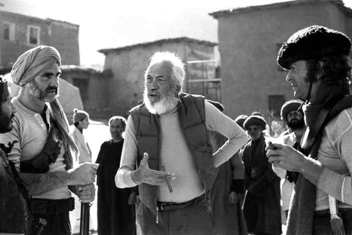 "By the time John Huston was turning Rodyard Kipling's adventure story ""The Man Who Would Be King"" into a movie, nearly four decades had passed since the author's death. This allowed for a far more satirical examination of British imperialism than Kipling would ever have allowed."