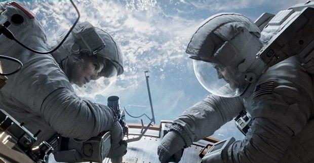 Ryan (Sandra Bullock) and Matt (George Clooney) in the midst of repairing a space craft before disaster strikes.