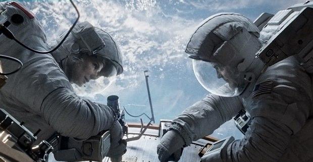 Ryan (Sandra Bullock) and Matt (George Clooney) in the midst of repairing a space craft before disaster strikes.