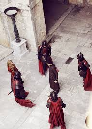 Cersei Lannister plays a Medieval version of Simon Says with her guards to showcase her power.
