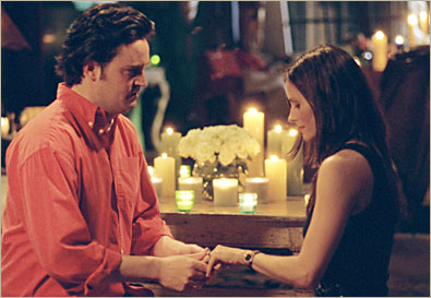 Chandler proposing to Monica.