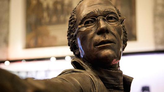 A bronze statue of Alexander Hamilton wearing his glasses in his fatal duel.