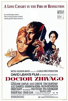 A movie poster (circa 1965) which represents the core concept of the movie. Centerpiece in this poster are Omar Sharif and Julie Christie