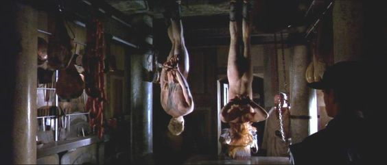 Both boys are hung and then have their throats cut. This image is from the film when it is happening. I do not own the rights to this image.