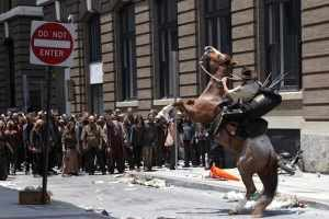 A confrontation when the main character, an ex-sheriff, tries to enter a city in The Walking Dead pilot.