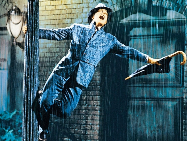 A stillshot showing Gene Kelly singing the title song of the movie.