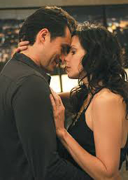 Mary-Louise Parker as Nancy Botwin and Demian Bichir as Esteban Reyes in Love. Weeds