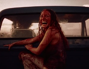 Sally (Texas Chainsaw Massacre) escaping a frustrated Leatherface