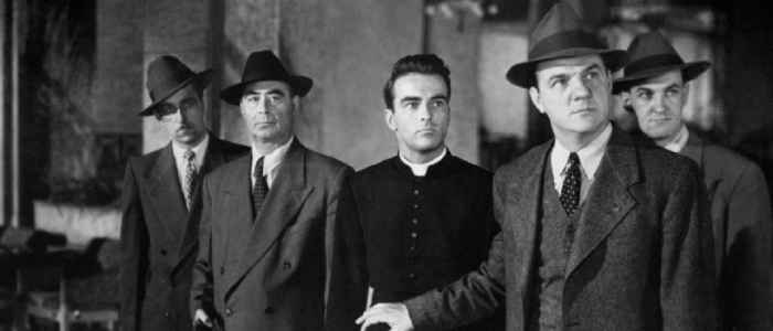 """Montgomery Clift (Center) and Karl Malden in Hitchcock's """"I Confess"""" (1953)."""
