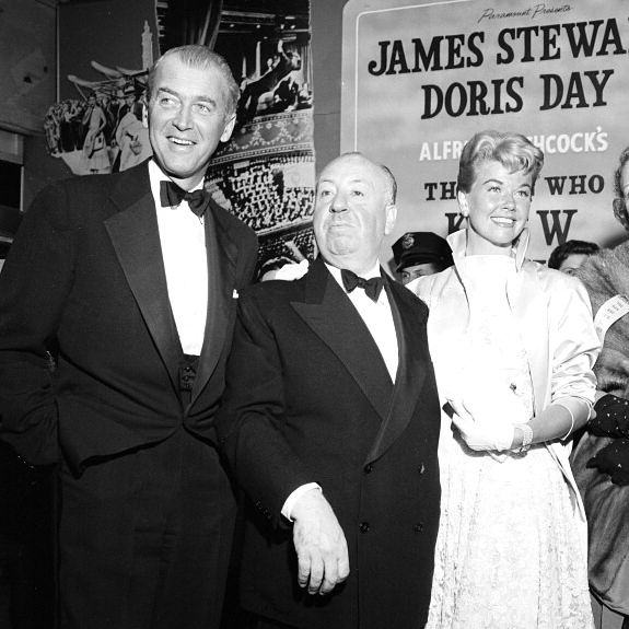 """Alfred Hitchcock (center) at the premiere of """"The Man Who Knew Too Much,"""" with James Stewart and Doris Day"""