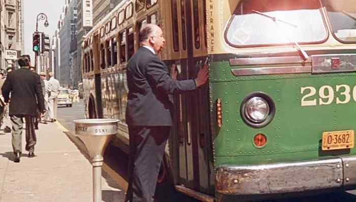 """Famous for his cameo appearances in his films, here director Alfred Hitchcock misses the bus at the beginning of """"North by Northwest"""""""