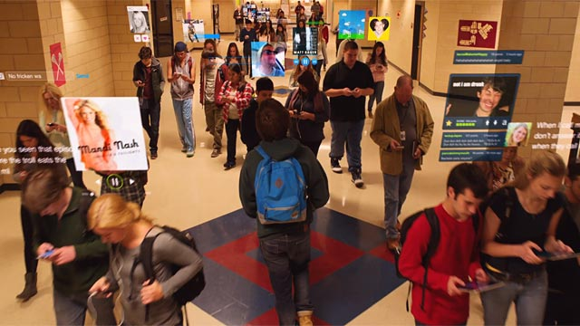 Still from the film Men, Women, and Children--showing school kinds walkabout absorbed in social media.