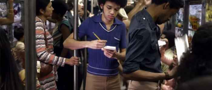 Zeke writing raps on the subway in The Get Down