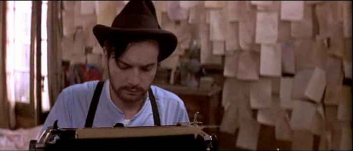 Christian writing at his typewriter in Moulin Rouge