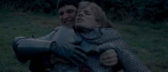 Merlin desperately trying to save his friend King Arthur in the series finale.