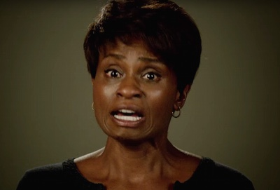 Lee Harris, played by Adina Porter, speaking in a mock interview for My Roanoke Nightmare. Source: https://skatronixxx.com/tag/andre-holland/