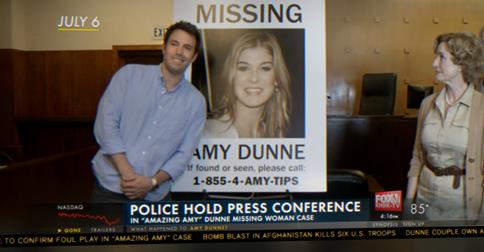 "The news media blasts Nick's behavior at a ""Find Amy"" fundraiser in Gone Girl."