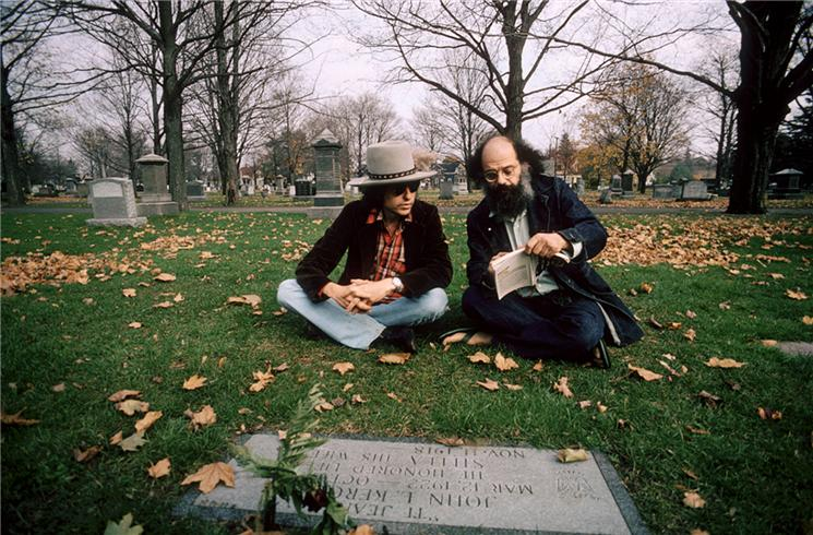 Dylan had a key affinity for the Beat Generation of writers, shown here with Allen Ginsberg at Jack Kerouac's grave