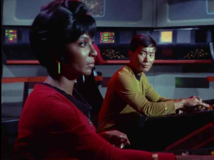 Uhura (Nichelle Nichols) and Sulu (George Takei) on the bridge of the Enterprise.