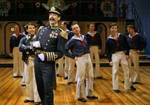 Robert O. Berdahl (Captain Corcoran) and the sailors from the cast of the Guthrie Theater's production of Gilbert and Sullivan's H.M.S. PINAFORE, with additional material by Jeffrey Hatcher. Directed by Joe Dowling, choreography and musical staging by David Bolger, set design by Frank Hallinan Flood, costume design by Fabio Toblini, lighting design by Malcolm Rippeth. June 18 – August 28, 2011.