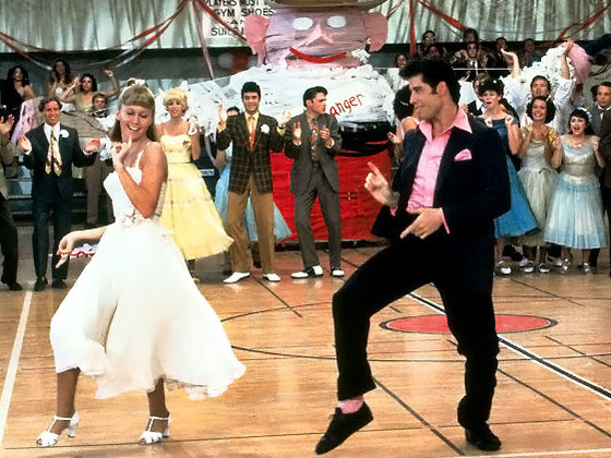 Grease uses 1950s nostalgia while the characters' dancing is closer to disco.